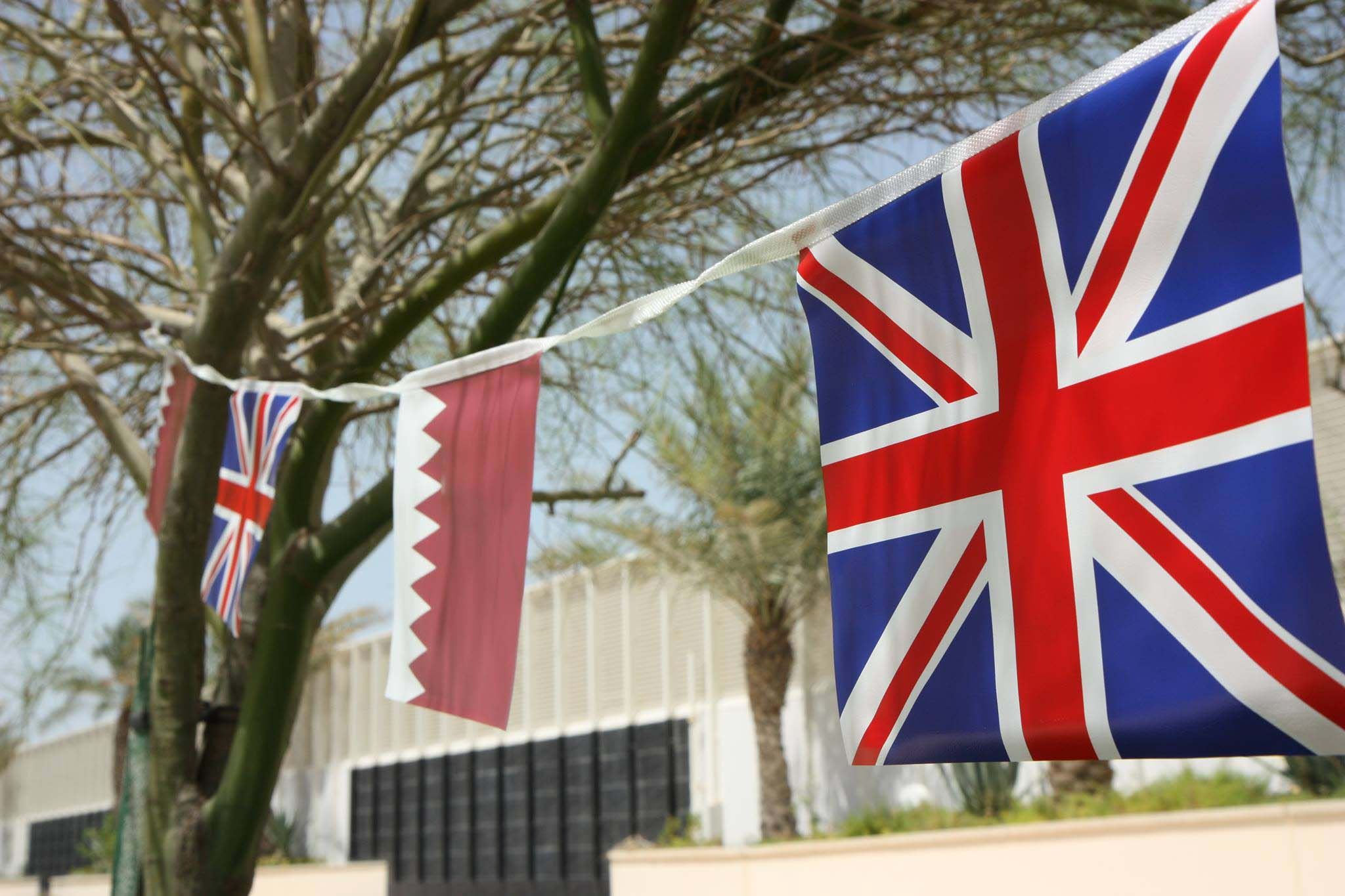 UK and Qatar flags